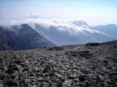 The summit plateaux on Scafell Pike looking along the main ridge to Broad Stand, Ill Crag and Great End immersed in clouds.