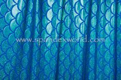 Kelly holographic fish scale foil patterns on royal poly spandex. (Patterns are lengthwise) Price: $14.00 /yd