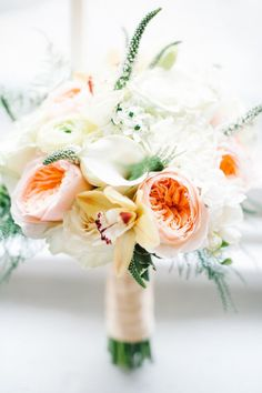 bouquet full of creamy whites and peach garden roses Photography by Brklyn View Photography / brklynview.com