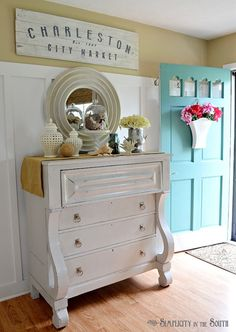 Unique white empire chest (that looks like it could be part of Beauty and the Beast with its hands on its knees), and super tall wainscoting