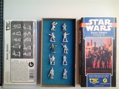 "This Star Wars ""Bounty Hunters"" Vintage Lead Figurine Set consists of 10 lead figurines, all roughly 1 inch/ 25mm in height, still in box, all unpainted except for Weequay. The date stamp on the bottom of all the figurines is 1988, along with ""Lucasfilm"" stamp."