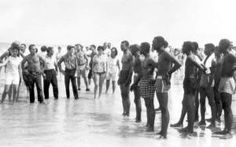 Confrontation between integrationists and segregationists on the beach.