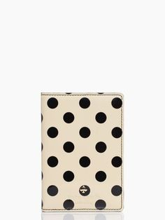 Check to see if you need your passport (and that it's not out of date!) and get a case - like this cute Kate Spade one - to keep all your travel documents safe and together.