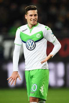 Julian Draxler Photos Photos - Julian Draxler of Wolfsburg ponders during the Bundesliga match between VfL Wolfsburg and Hamburger SV at Volkswagen Arena on December 12, 2015 in Wolfsburg, Germany. - VfL Wolfsburg v Hamburger SV - Bundesliga