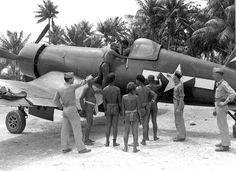 American pilots show Pacific island aboriginals a Chance-Vought F4U Corsair (1945).
