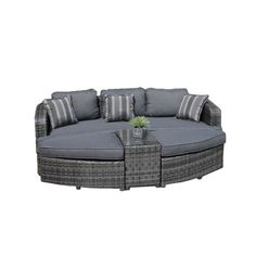 A perfect anchor for your sunroom or veranda, this stylish wicker daybed group showcases water-resistant cushions in grey.Product: