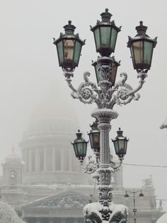Russia, Saint-Petersburg, Old fashion street light with Saint Isaac's Cathedral in background, Winter