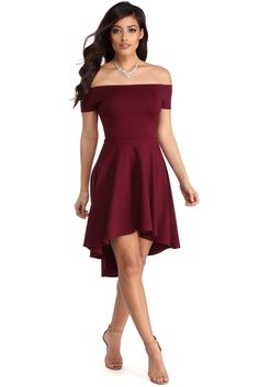 """<p>Off the shoulder dresses are all the rage this season! Show off your amazing fashion sense with this dress that features an elastic off the shoulder neckline, a short sleeve, a slim fitting bodice and a super cute skater skirt with a hi low hem.</p>  <p><em>Model is 5'7 with a 34"""" bust, 24"""" waist and 36"""" hips. She is wearing a size small.</em><o:p></o:p></p>"""