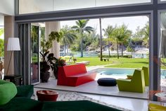 Folding doors open up to a spectacular backyard at the Tequesta Residence.   Gallery | NanaWall