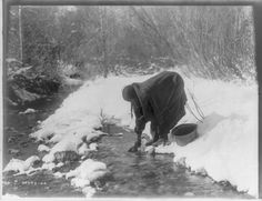 On a wintry day c.1906, Edward Curtis took a picture of this Apsaroke woman (see also Apsáalooke, or The Crow Nation) as she bent down to get water from a stream. This image is now available from the Library of Congress Prints and Photographs Division.