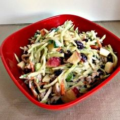 Broccoli Apple Slaw - Crunchy shredded Broccoli, carrots, apples, walnuts, and dried cranberries with a tangy dressing