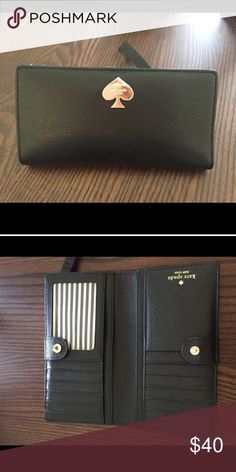 Kate spade Stacy black wallet Super cute! Definitely worn has some scratches but still good condition kate spade Bags Wallets