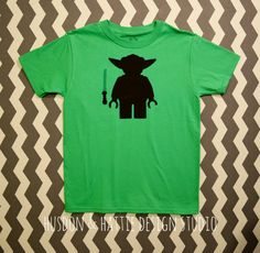 Your Birthday It Is... This adorable shirt is appliqued with a Lego style Yoda and a green light saber in black fabric! It can also feature a