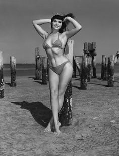 """Bettie Page -Bettie Mae Page (April 22, 1923 – December 11, 2008) was an American model who became famous in the 1950s for her pin-up photos. Often referred to as the """"Queen of Pinups"""", her jet black hair, blue eyes, and trademark bangs have influenced many artists."""