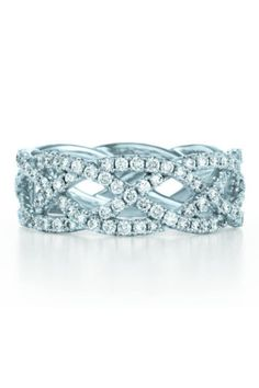 Four rows of woven diamonds: http://www.stylemepretty.com/2014/11/15/20-drool-worthy-wedding-bands/