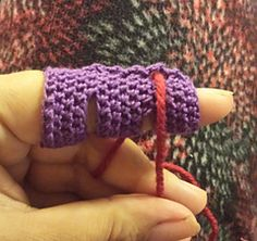 """Finger Cozy free pattern on Ravelry - """"This finger cozy is designed to allow you to maneuver up to 5 strands of yarn or thread at a time for fair isle knitting, graphgans, and other color work or to place a single strand where it is most comfortable on your finger. Protects the finger from too much friction or for low quality yarns that may rub the finger raw."""""""