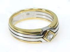 Ladies ring set with 1 diamond Carrée.  WG / GG 18 K. Ring size about 55 UNWORN. * Leg. 750/000 * 8.1 g weight - Price: 600 EUR