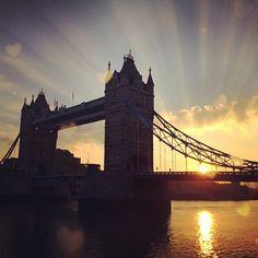 The sun rising behind Tower Bridge in #London 9°C | 48°F #BurberryWeather