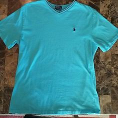 Ralph Lauren Boys Polo Shirt Ralph Lauren Boys Polo Shirt in great used condition. This is a boys shirt not mens. Turquoise color with navy blue horse and lining. Ralph Lauren Tops Tees - Short Sleeve