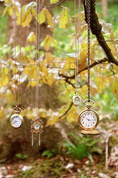 Hang broken or dead battery inexpensive watches in your fairy garden.