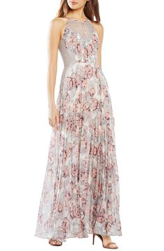 Look effortlessly glam with this pleated gown from BCBGMAXAZRIA. A romantic medley of delicate lace insets and pastel floral prints play up its flowy silhouette. Perfect for prom!