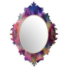 """An eye-catching addition to your study or entryway, this chic wall mirror features a Baroque-inspired silhouette and an abstract multicolor motif. Made in the USA.  Product: Wall mirrorConstruction Material: Aluminum, engineered wood and mirrored glassColor: Purple and multi frameFeatures:  High gloss frameUV-resistant coatingReady to hang Made in the USA Designed by Amy Sia for DENY Designs  Dimensions: 29.2"""" H x 21.7"""" W x 1.5"""" D"""