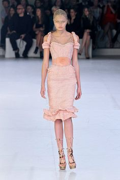 This is pretty. Don't knock the head/face piece. It's Alexander McQueen... he can do what he want, yo. Spring 2012 RTW