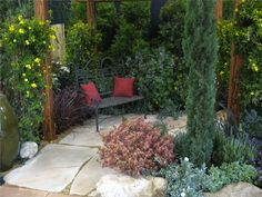 The layered planting around this small-space patio makes the area feel much roomier than it is. Landscape design by Designs by Shellene in San Diego, CA. Learn more about designing meditative spaces here: http://www.landscapingnetwork.com/gardening-ideas/meditation.html#