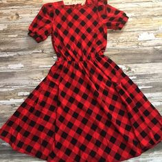 """Vintage Checkered Plaid Dress Red & Black Buffalo Plaid Check.  Soft Flannel Material.  100% Cotton.  Shoulder Pads.  Banded Button Close Sleeve.  Elastic Middle.  Belt Loops.  ILGWU Garment.  Made in USA.  Tag Size 11.  Bust 34"""" Length 45"""".  Sweep 45"""". On Trend-Grunge / Holiday style.  True Vintage Dress.  Very Good - Excellent Condition.  Some Light Piling to the Material. Unknown- ILGWU Garment Dresses Midi"""