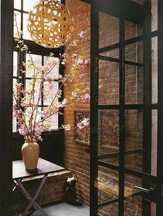 Exposed brick + those window/door frames + gorgeous yellow hanging thing = amazing combo