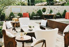 look at all the awesome lounge furniture at this eclectic wedding! lots of seating for guests to mix and mingle.