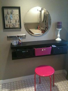 We ended up stealing several Pinterest ideas here. a DIY vanity with Ikea shelves, used a magnet to use for my bobby pins and an old picture frame for earrings!