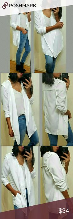 "《••NEW••》 WHITE OPEN CARDI JACKET Gorgeous white open cardi/jacket. Vendor puts it as ""jacket"" I'd say it's more like an open cardi. Inside out outer stitching. Strap button on shoulders. Great for a night out or for a casual outting 💕 Lightweight. Fits TTS.  Sizes available S M l •Modeling size Medium •  PRICE FIRM UNLESS BUNDLED  JMAY4354 Jackets & Coats Utility Jackets"