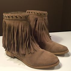 """Michael Kors Billy Bootie Michael Kors """"Billy"""" bootie. Khaki colored suede with long fringe around the ankle and gold hardware. Studs line the tops of the booties and Michael Kors plaques are on the heels. The soles are wood and rubber. Marked size 6 but would definitely fit a 5.5. They're a tight squeeze and I'm a true size 6 Michael Kors Shoes Ankle Boots & Booties"""