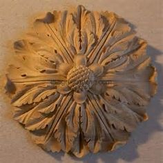 The rosette by definition is an artificial rose. In a broader sense, any ornament that is circular in shape and radiates from a centre may be defined as a rosette. Wood Carving Designs, Wood Carving Patterns, Wood Rosettes, Wood Appliques, Decorative Mouldings, Stone Carving, Carving Wood, Wood Carvings, Luminaire Design