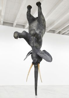 I think the better question is, WHY NOT balance an elephant upside down on its trunk? Exhibition by Daniel Firman