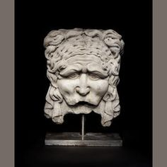 A Roman marble mask relief Circa 2nd Century A.D.