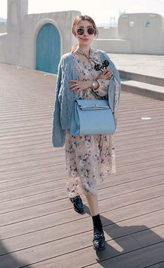 Get this look: http://lb.nu/look/8084028  More looks by Miamiyu K: http://lb.nu/miamiyu  Items in this look:  Miamasvin Chunky Cable Knit V Neck Cardigan, Miamasvin Floral Elastic Waist Midi Dress With Matching Scarf Set, Miamasvin Studded Chain Accent Loafers   #winterfashion #koreanfashion #chic #streetstyle