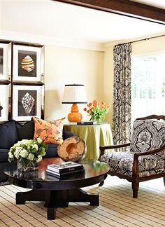 It's so nice to see a black sofa that isn't ultra sleek/modern and is displayed in a light and airy room!