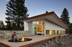 Fire pit area could be like this...  Same retaining condition as we have.  I like the recessed pit. Understated but bold in contrast to the open deck  Hill House by David Coleman Architecture | Home Architectural Design