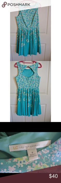 Lauren Conrad formal floral dress Never worn! This dress has a very cute open back and high neck line. It has two loops for a belt which I've lost, but you could easily replace! Very cute for weddings, parties, etc. LC Lauren Conrad Dresses Wedding