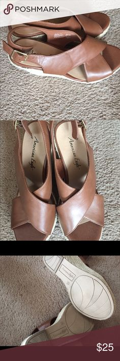 American Eagle wedge peep toes. Size 8 1/2. American Eagle wedge peep toe sandals. Beautiful British Tan color. Worn only once for a graduation exercise. Comfortable. Heels just aren't my thing. American Eagle by Payless Shoes Platforms