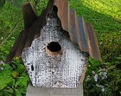 Birdhouse made from old barn sidind