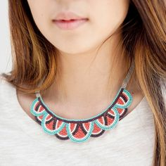 vivid ivory, turquoise, coral, and brown beads.