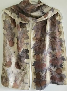 Eco print silk scarf with Maple and Eucalyptus leaves. All the color comes from the pigments in the leaves, with the assist of some rust and steam. It makes a nice wall hanging when not being worn as a scarf. 100% Silk - This silk is especially soft, light and airy. 11 x 60 COLORS are