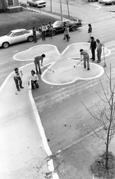 St. Patrick's Day 1980: Michael McCarville and friends have done it again. For the past three years, McCarville has been the chief artist during the painting of a shamrock in front of the Marylebone Tavern, 3710 Leavenworth St. in Omaha. THE WORLD-HERALD