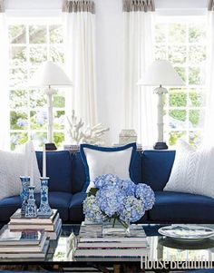 Living room decorated with brilliant #blues & bright whites.