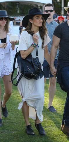 Nikki Reed looked gorgeous in our Sacha Moto Shootie at Coachella! #CoachellaFashion #Coachella2015 #FRYESPOTTED