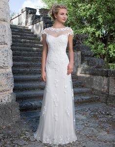 Sincerity wedding dress style 3880 �A Sabrina neckline jacket accents this sweetheart straight gown featuring a tulle overlay, lace appliques, and a lace hem. The stretch Jersey lining makes this gown garden wedding approved.