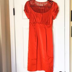 Susana Monaco Orange Silk Sheath Dress XS Susana Monaco orange silk dress that I think is Anthropologie (does not have care tags fwiw).   Inherited it when a friend moved, but it's too tiny for me and my runner's butt.  It has 2 tiny tears by the tag in the back (see image 4). I can post more pics, but can't model it since it won't fit on me.  Measurements are 38 in shoulder to hem, 13.5 in waist, and 15.5 in hips. It's really pretty, it just won't fit!  Feel free to make an offer! I can't…